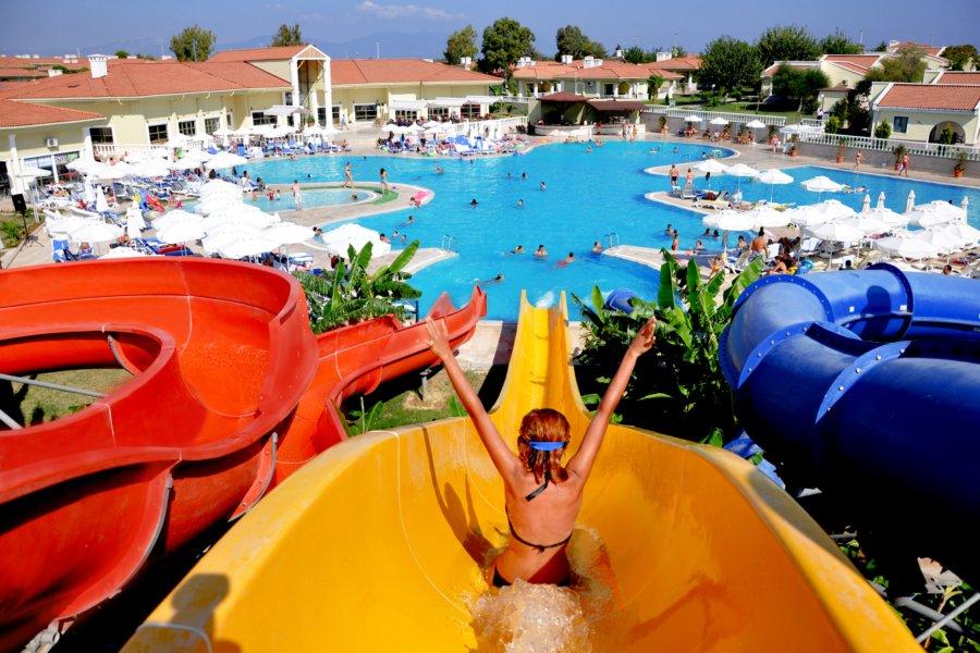 https://aventur.ro/assets/media/imagini_hoteluri/DIPALM/Palm_Wings_Beach_Spa_Didim_piscina_tobogane.jpg