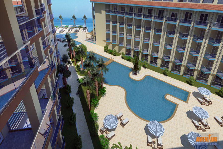 https://aventur.ro/assets/media/imagini_hoteluri/KURAMH/Kusadasi_Ramada-Hotel-Suites-Pool1.jpg